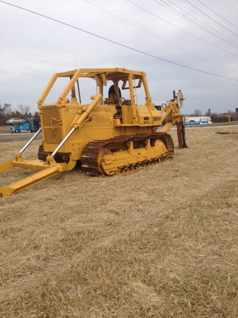 This Komatsu with Ateco cable plow has been reported in excellent condition.