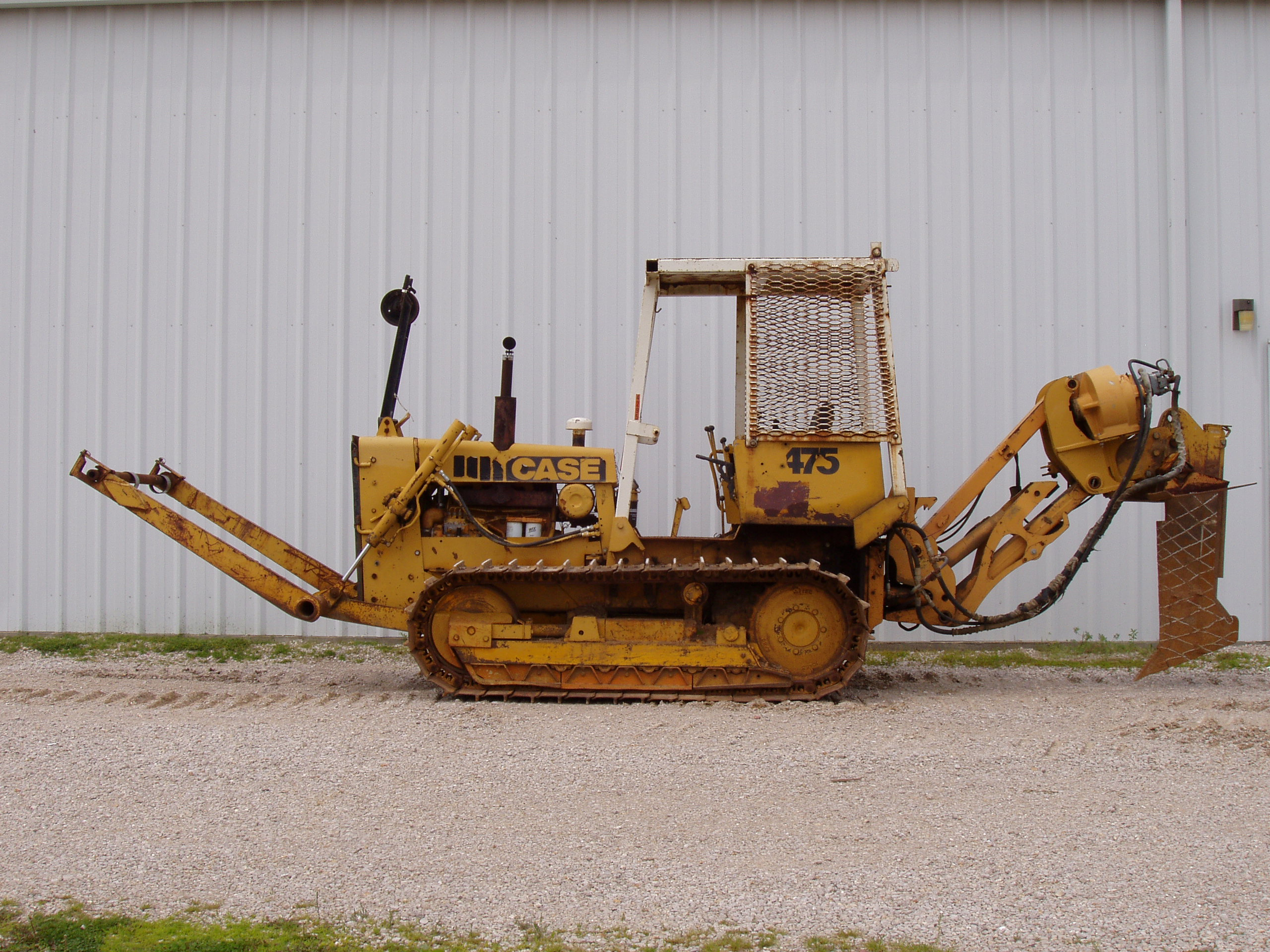 Contact Garner Equipment about this Case 475 cable plow with Case 860 steerable plow attachment.
